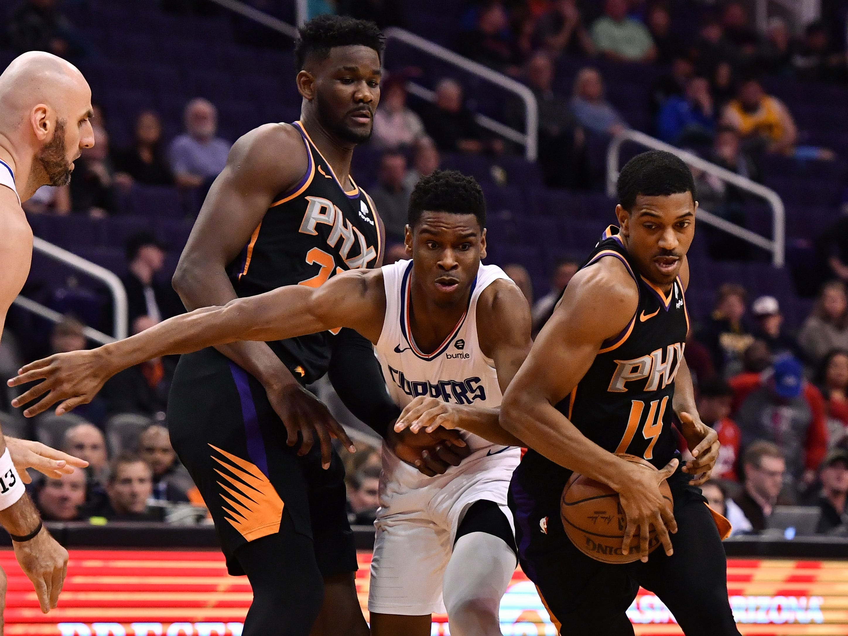 Jan 4, 2019; Phoenix, AZ, USA; Phoenix Suns guard De'Anthony Melton (14) handles the ball against LA Clippers guard Shai Gilgeous-Alexander (2) in the first half at Talking Stick Resort Arena. Mandatory Credit: Jennifer Stewart-USA TODAY Sports