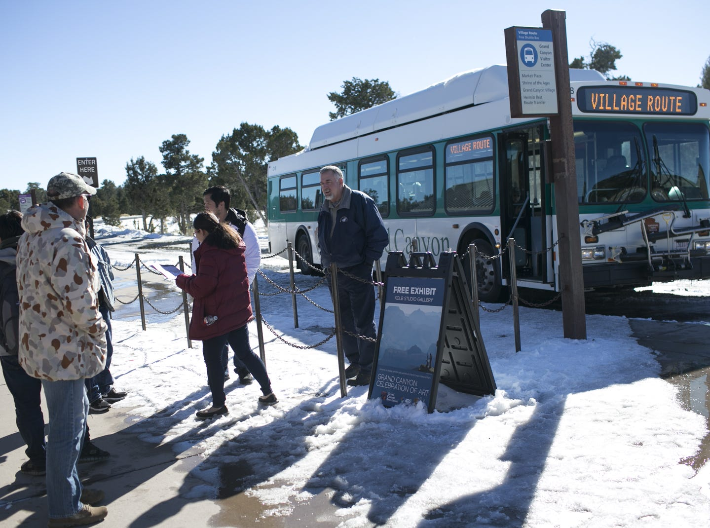 Visitors wait to ride a shuttle bus at Grand Canyon National Park on Jan. 4, 2019. The park was staffed at minimum capacity due to the government shutdown but retained much of its services due to an executive order issued by Arizona Gov. Doug Ducey to run the park with state funds in the event of a shutdown.