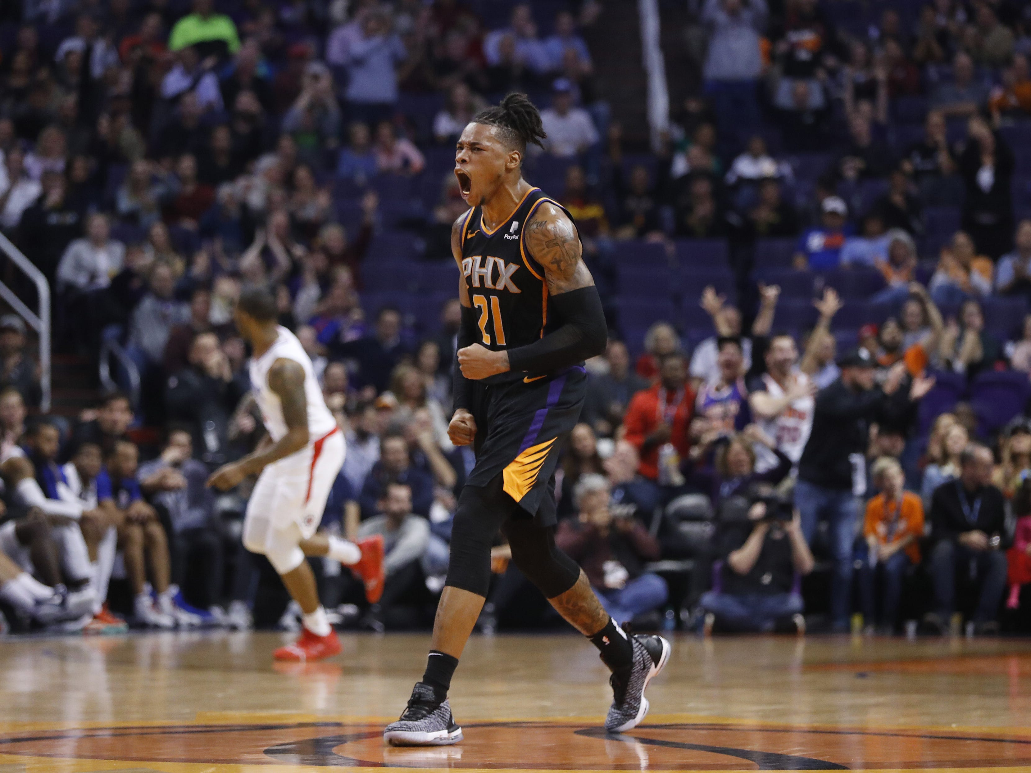 Suns' Richaun Holmes (21) reacts after the Suns pull within 13 against the Clippers during the second half at Talking Stick Resort Arena in Phoenix, Ariz. on January 4, 2019.