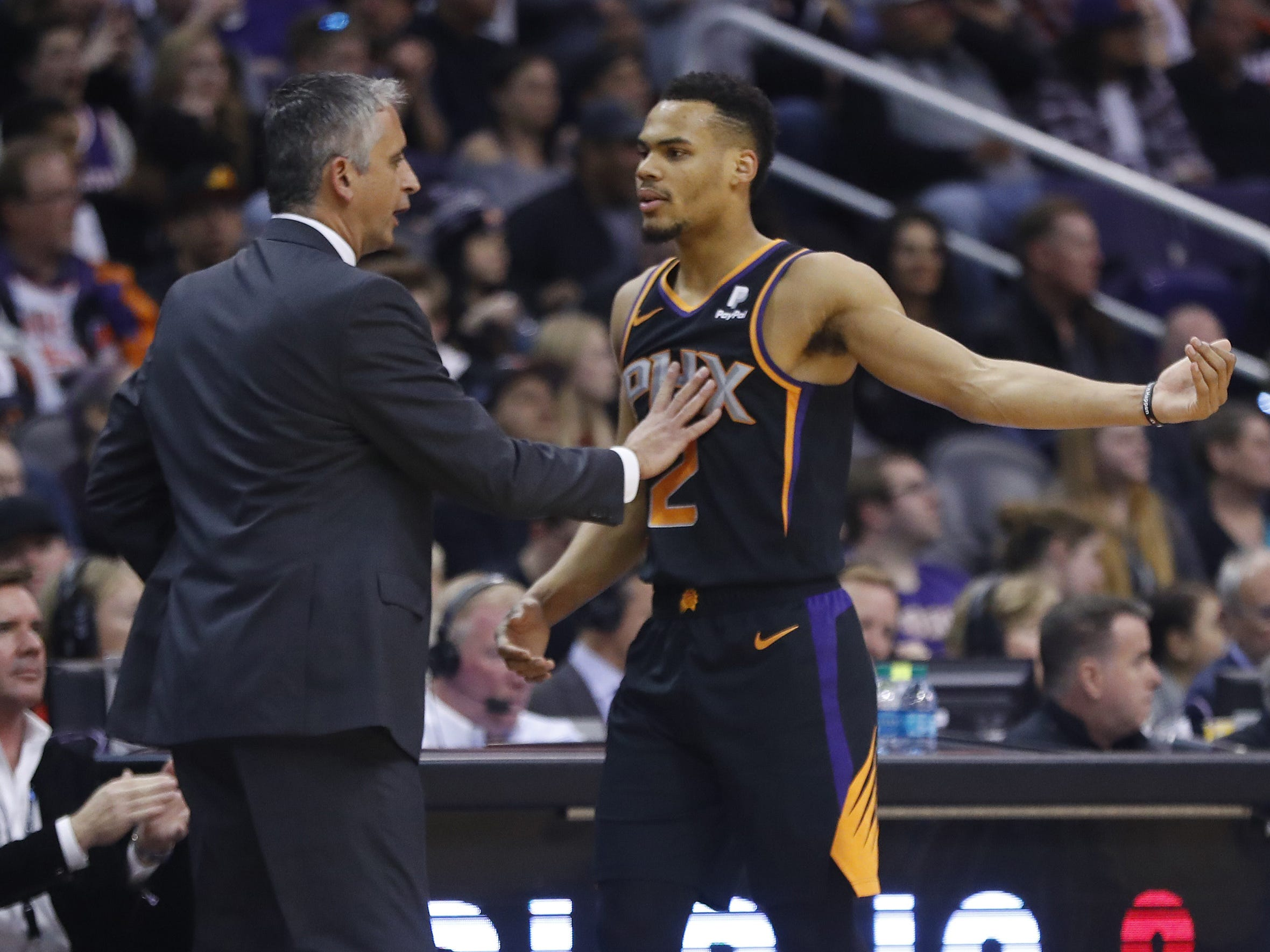Suns' Igor Kokoskov puts his hand on Elie Okobo (2) as they talk during the second half at Talking Stick Resort Arena in Phoenix, Ariz. on January 4, 2019.
