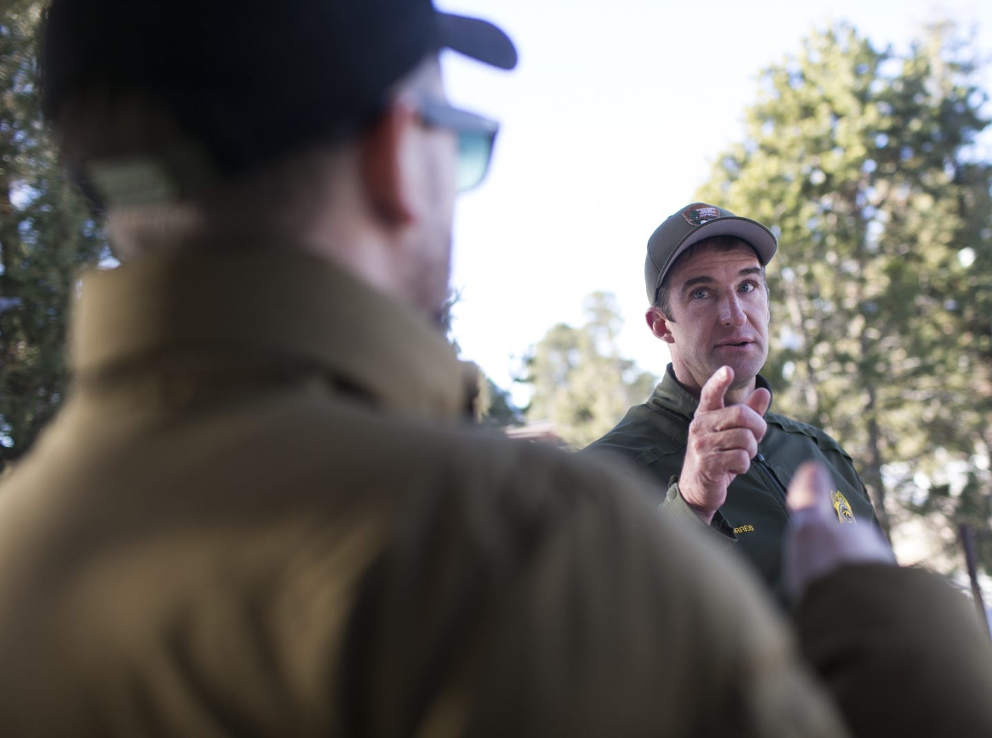 Brandon Torres (right), the Branch Chief of Emergency Services at Grand Canyon National Park, directs guests in the park on Jan. 4, 2019. The park was staffed at minimum capacity due to the government shutdown but retained much of its services due to an executive order issued by Arizona Gov. Doug Ducey to run the park with state funds in the event of a shutdown.