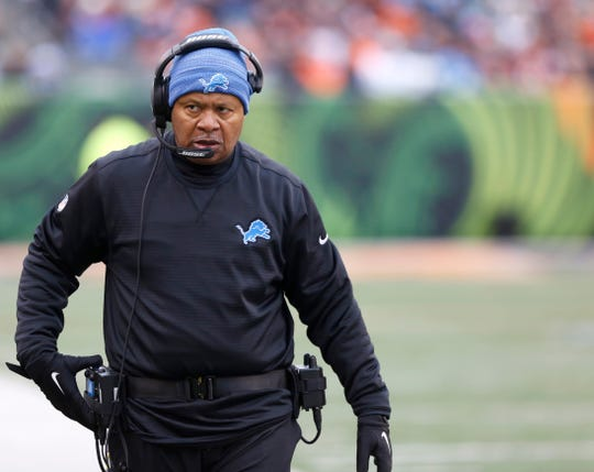 Lions coach Jim Caldwell walks down the field during the first half of a game against the Bengals on Dec. 24, 2017 at Paul Brown Stadium.