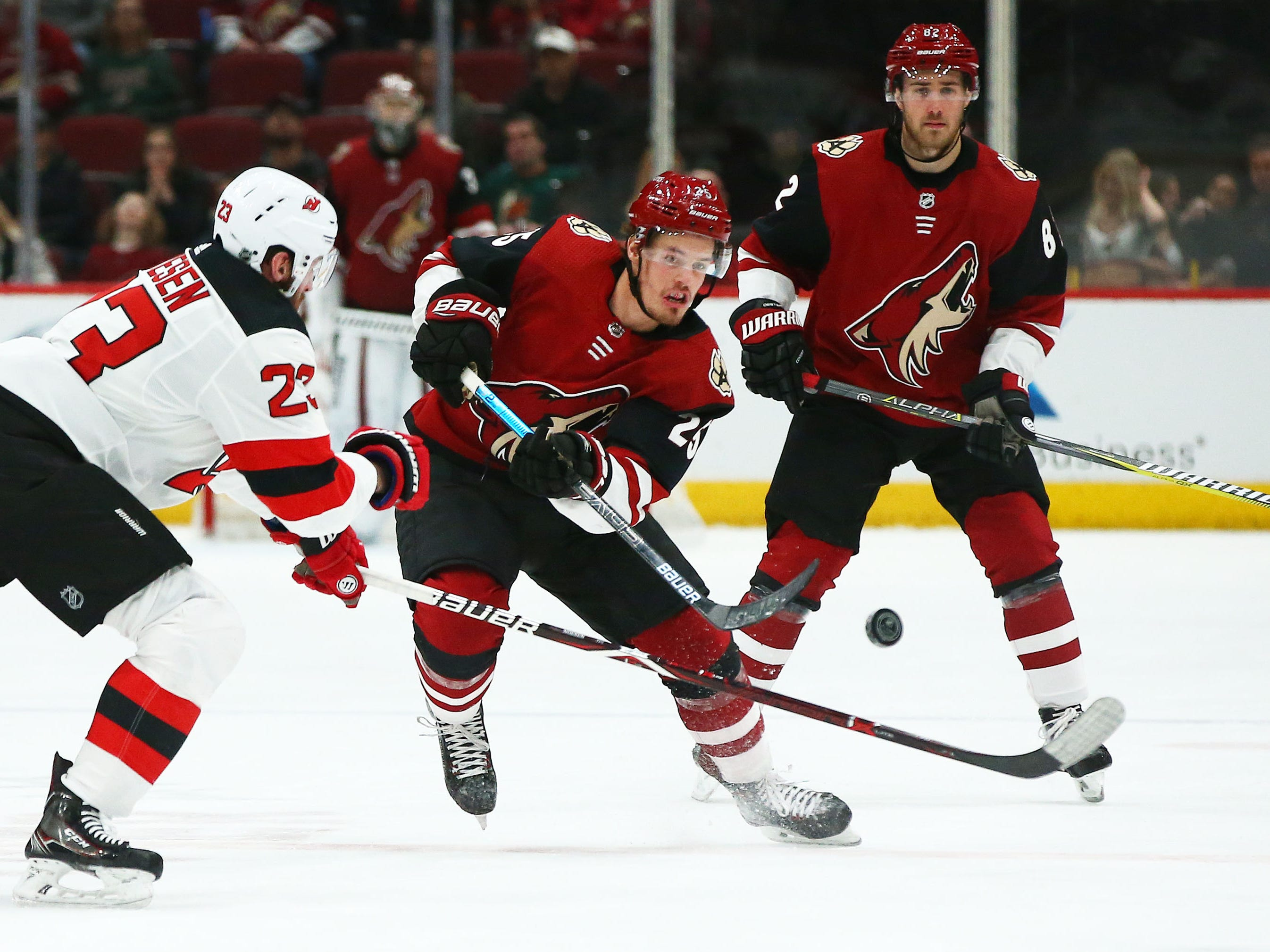 Arizona Coyotes' Nick Cousins (25) controls the puck against the New Jersey Devils in the second period on Jan. 4 at Gila River Arena.