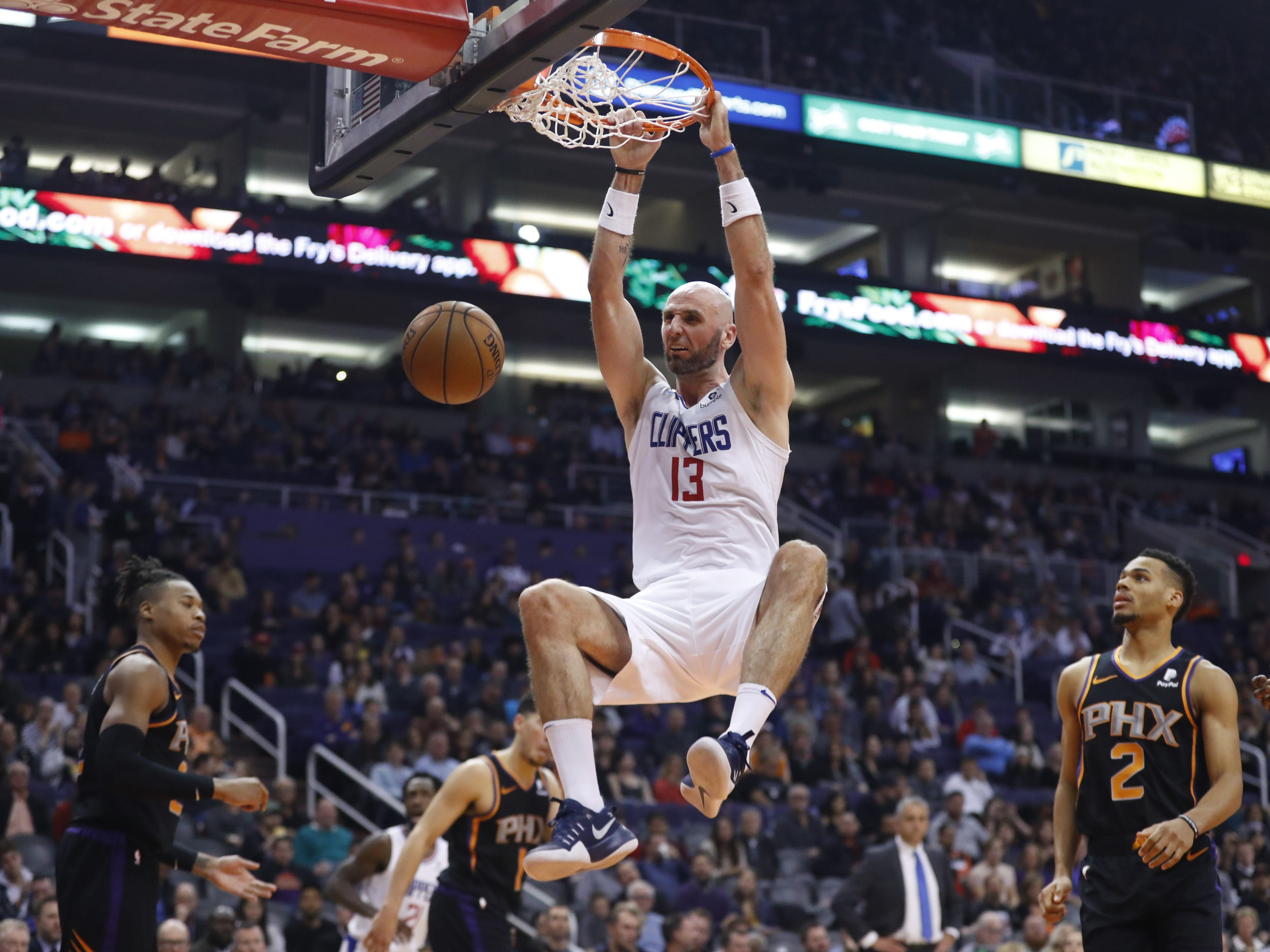 Clippers' Marcin Gortat (13) dunks against the Suns during the second half at Talking Stick Resort Arena in Phoenix, Ariz. on January 4, 2019.