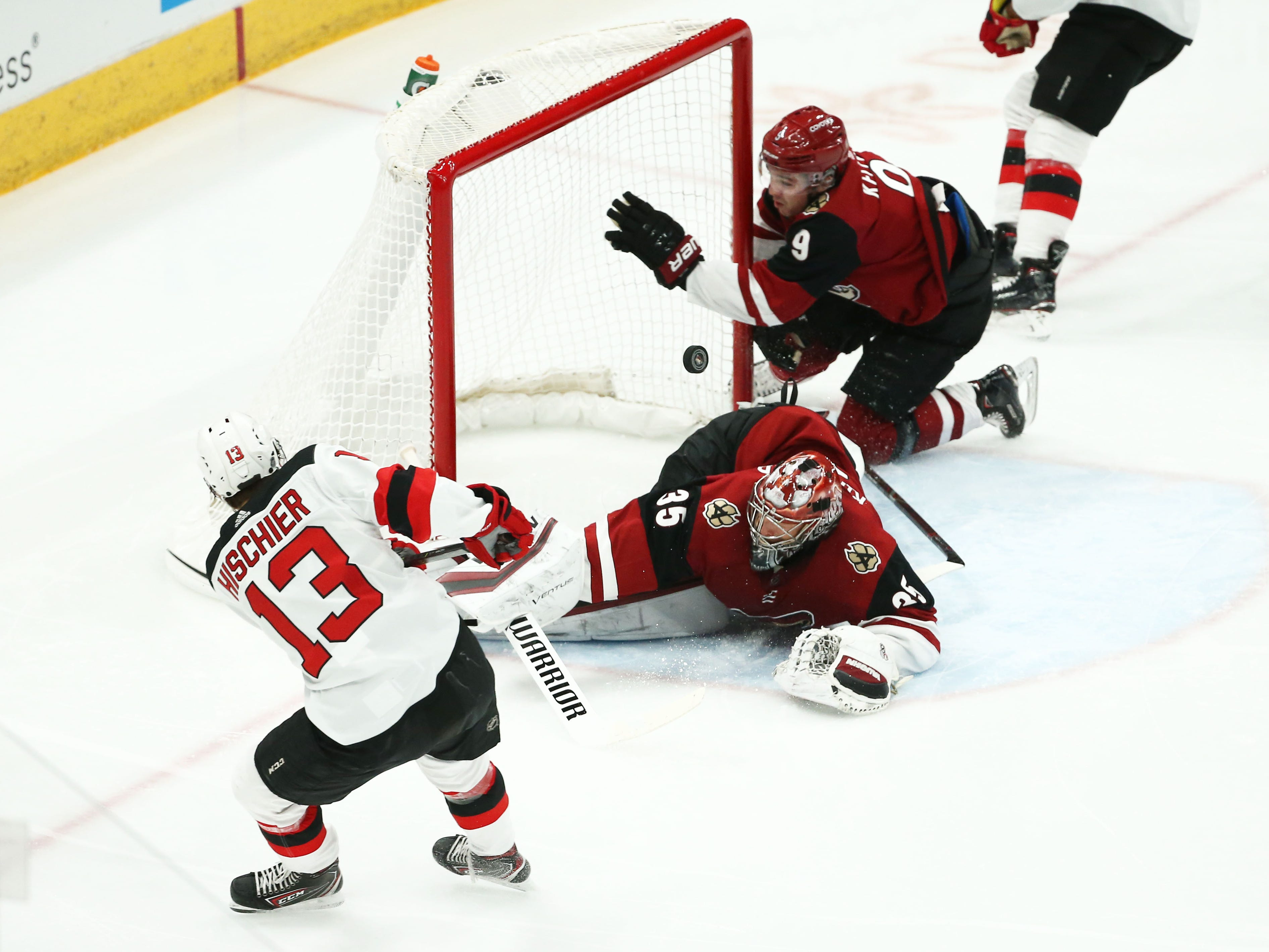 Arizona Coyotes' Clayton Keller knocks the goal away as New Jersey Devils' Nico Hischier scores a goal in the 1st period on Jan. 4 at Gila River Arena.