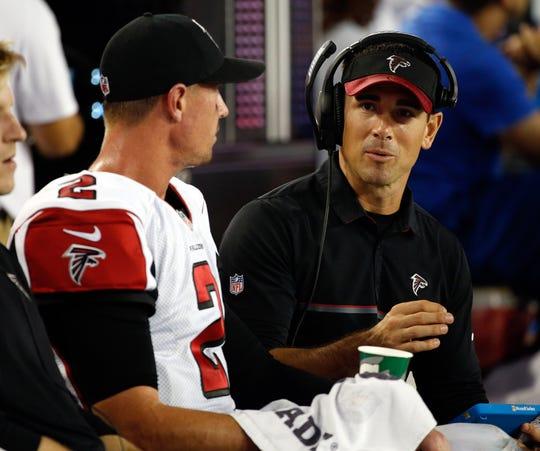 Falcons quarterback Matt Ryan talks with quarterbacks coach Matt LaFleur during a game in 2016 when he was the NFL MVP.