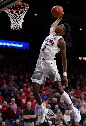 Arizona Wildcats guard Brandon Randolph soars for a breakaway jam after a steal during the first half of the University of Arizona Wildcats vs. University of Utah Runnin' Utes men's college basketball game, Jan. 5, 2019, in McKale Center.