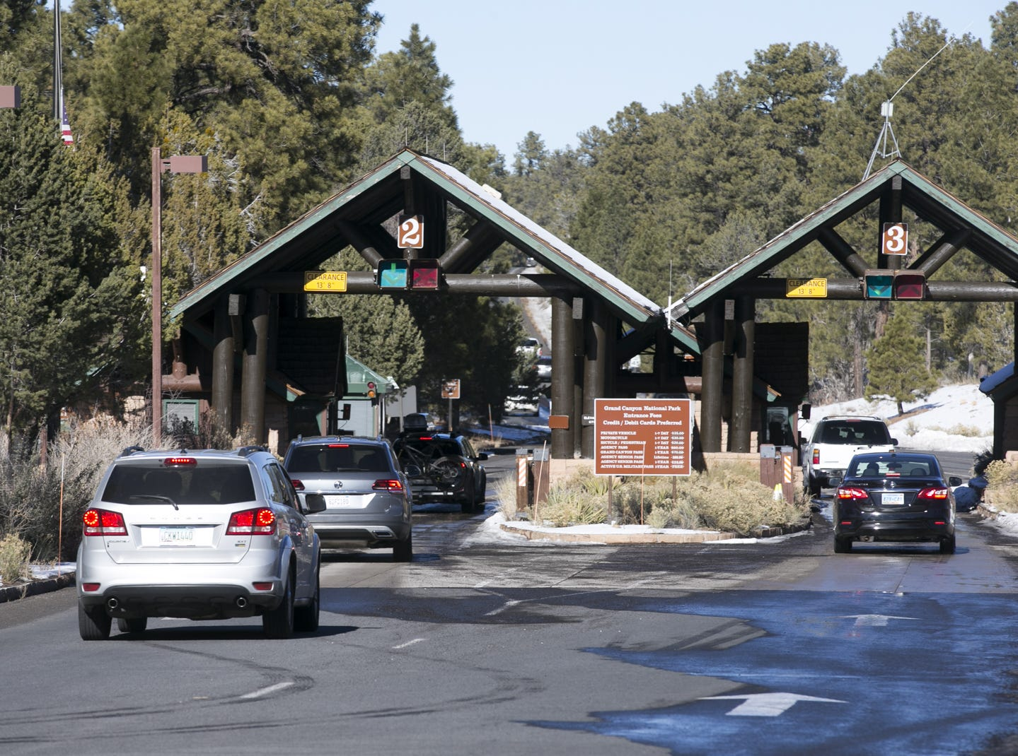 Visitors pass through the main entrance and enter freely at Grand Canyon National Park on Jan. 4, 2019. The park was staffed at minimum capacity due to the government shutdown but retained much of its services due to an executive order issued by Arizona Gov. Doug Ducey to run the park with state funds in the event of a shutdown.