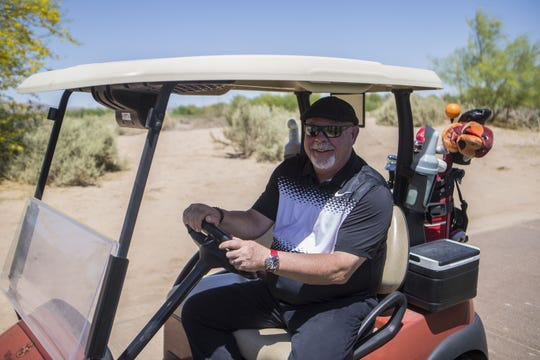 Former Cardinals head coach Bruce Arians rides in a cart at the 2018 Arizona Celebrity Golf Classic on April 14.