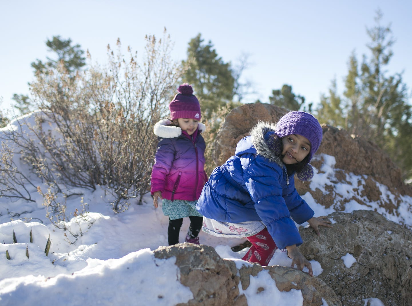 2-year-old Avanya Sharma (left) and her sister, 5-year-old  Navya Sharma (right), visiting with their family from Seattle,  play in the snow at Grand Canyon National Park on Jan. 4, 2019. The park was staffed at minimum capacity due to the government shutdown but retained much of its services due to an executive order issued by Arizona Gov. Doug Ducey to run the park with state funds in the event of a shutdown.