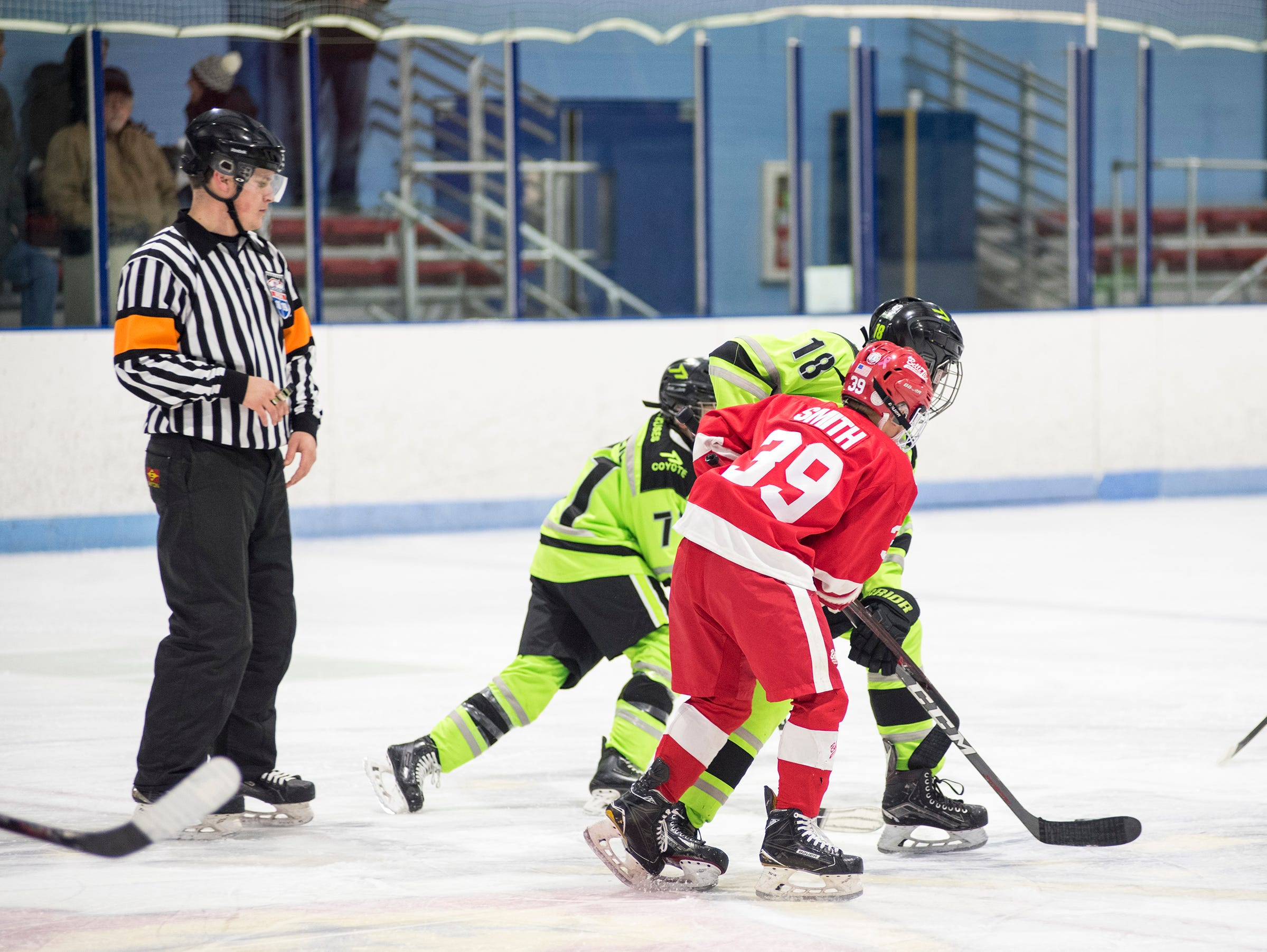 Detroit Belle Tire forward Brecken Smith (39) faces off against Chicago Mission forward John Greer during their PAAA-B Silver Stick Finals match Saturday, Jan. 5, 2019 at Glacier Pointe Ice Complex.