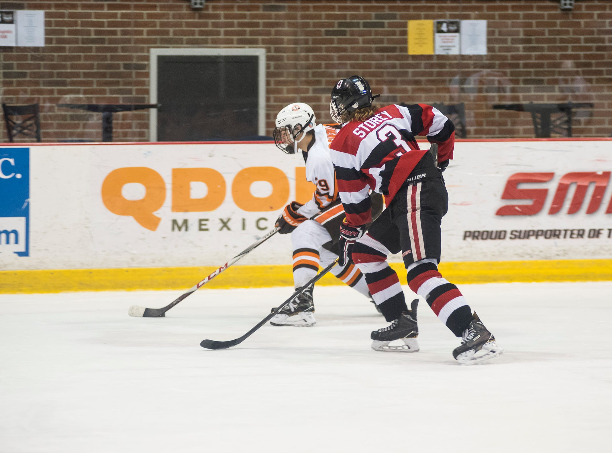 Ottawa Jr. 67s defenseman Will Storey (3) skates after Detroit Compuware forward Samuel Assinewei during their BAAA-B Silver Stick Finals match Saturday, Jan. 5, 2019 at McMorran Arena.