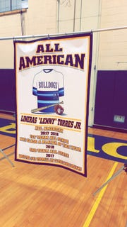 Banner listing Lenny Torres' accomplishments at Beacon High School.