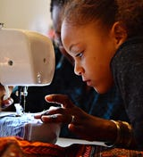 Children learn how to sew during a workshop at Gusa by Victoria in York City, Saturday, Jan. 5, 2019.