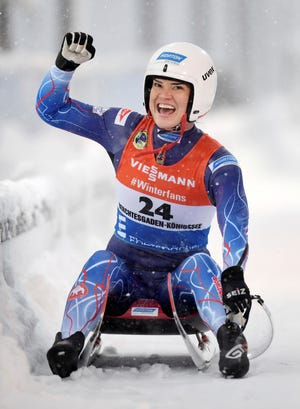 Glen Rock's Summer Britcher celebrates after finishing second in the women's World Cup luge event in Koenigssee, Germany, Saturday, Jan.5, 2019. (Tobias Hase/dpa via AP)