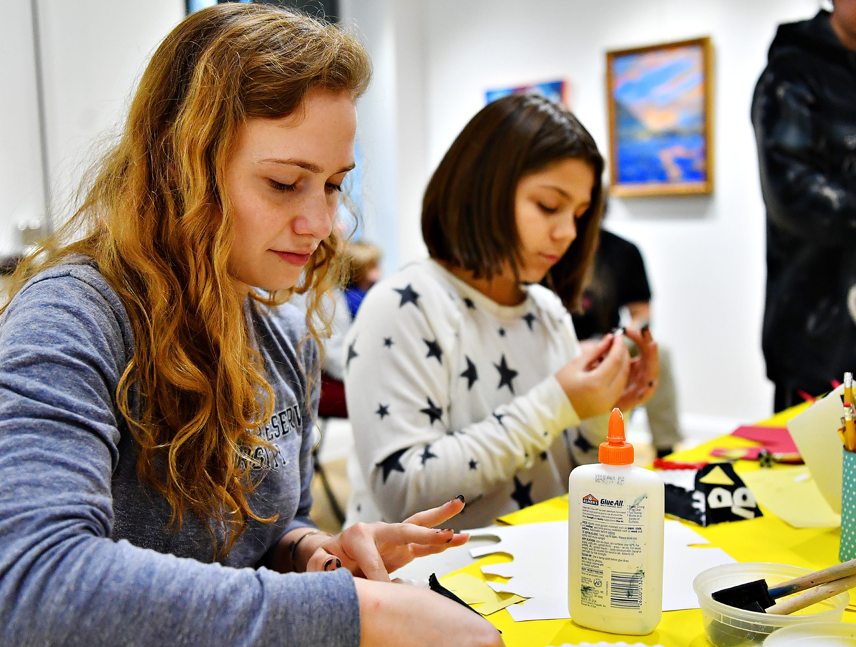Abigail Yaffe, left, and her sister Sophia Cotto, 11, both of Seven Valleys, build paper penguins during the first First Friday of the year at Creative York in York City, Friday, Jan. 4, 2019. Dawn J. Sagert photo