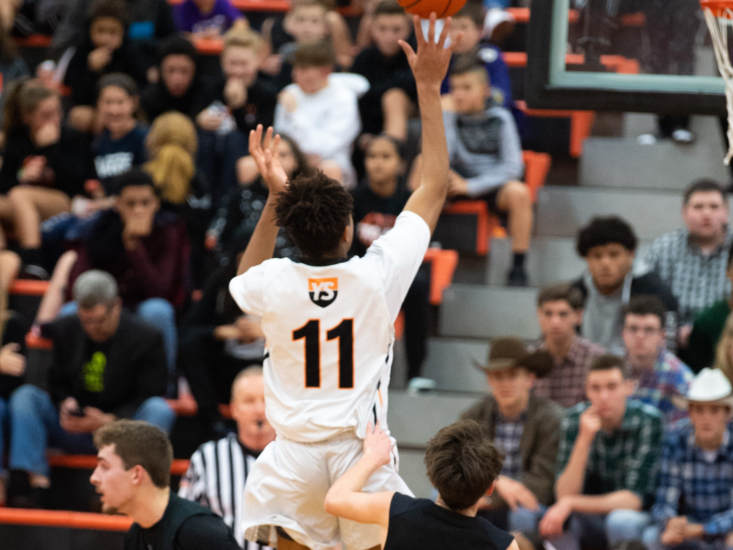 Alon Gorham (11) throws up the shot before Carter Day (55) can get to him during the boys' basketball game between York Suburban and Kennard-Dale at, January, 4, 2019. The Rams beat the Trojans 65 to 63 in overtime.