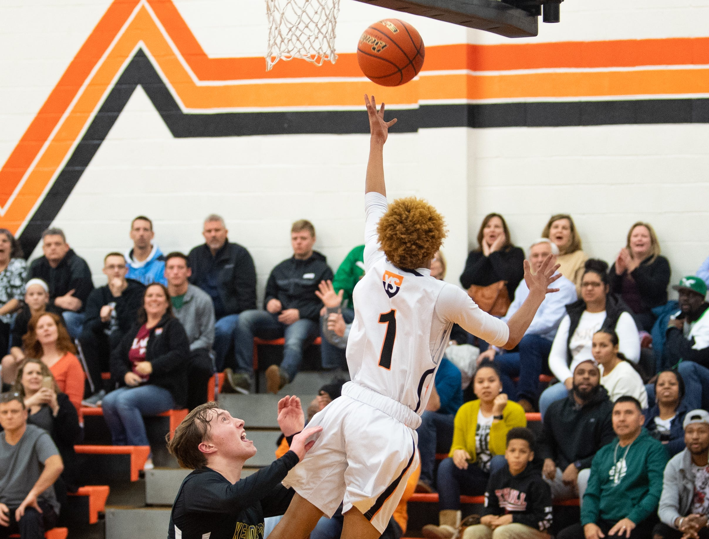 Cedric Walker (1) lays the ball up during the boys' basketball game between York Suburban and Kennard-Dale at York Suburban High School on January, 4, 2019. The Rams beat the Trojans 65 to 63 in overtime.