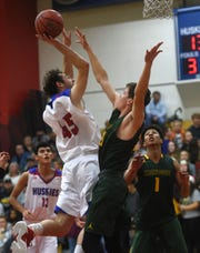 Reno's Jasin Ferati shoots while taking on Bishop Manogue during their basketball game in Reno on Dec. 14, 2018.