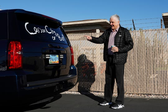 Nevada Governor-elect Steve Sisolak reacts to a message written on his vehicle after visiting an International Alliance of Theatrical Stage Employees union hall Friday, Jan. 4, 2019, in Las Vegas. The visit was one stop on a road trip through Nevada before his inauguration Monday in Carson City, Nev. (AP Photo/John Locher)