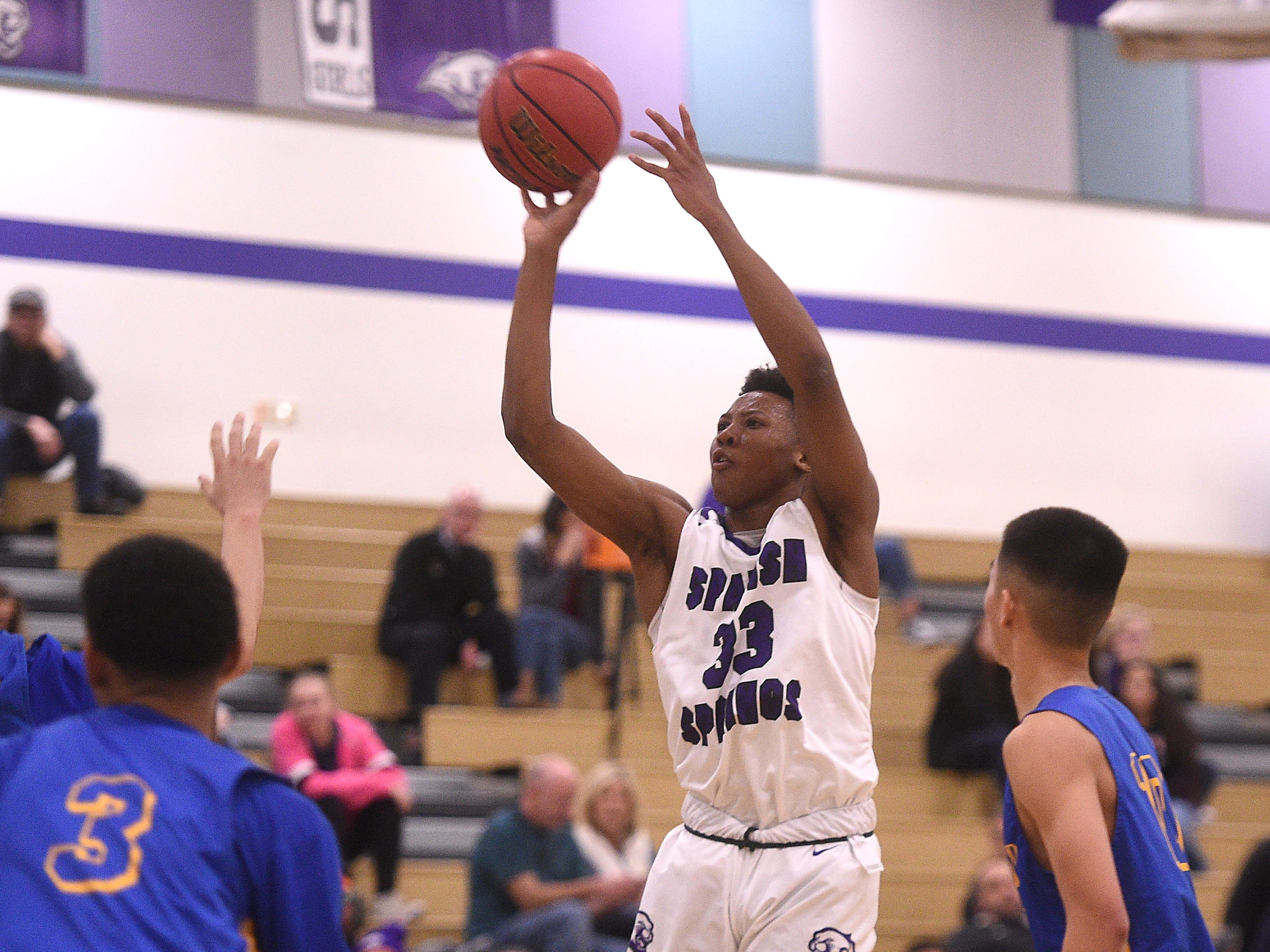 Spanish Springs' Cordell Stinson (33) shoots while taking on Lincoln during their basketball game in Reno on Jan. 4, 2019.