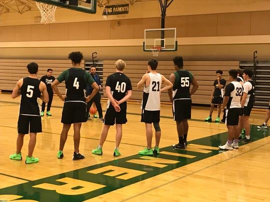 Bishop Manogue coach Moe Golshani talks to the Miners at practice last week.
