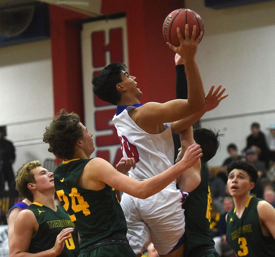 Reno's Skylar Hales shoots while taking on Bishop Manogue during their basketball game in Reno on Dec. 14, 2018.