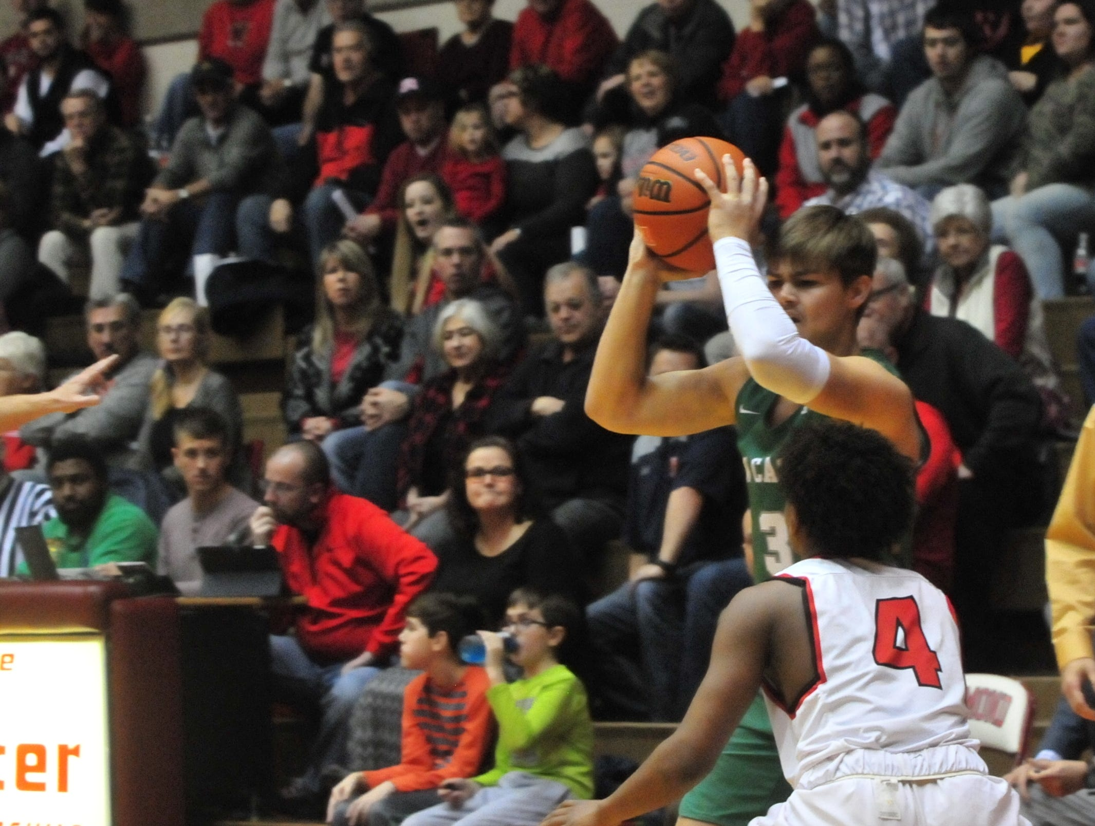 New Castle senior Luke Bumbalough (3) moves the ball against Richmond junior Koream Jett (4) during a boys basketball game at Tiernan Center Friday, Jan. 4, 2019.