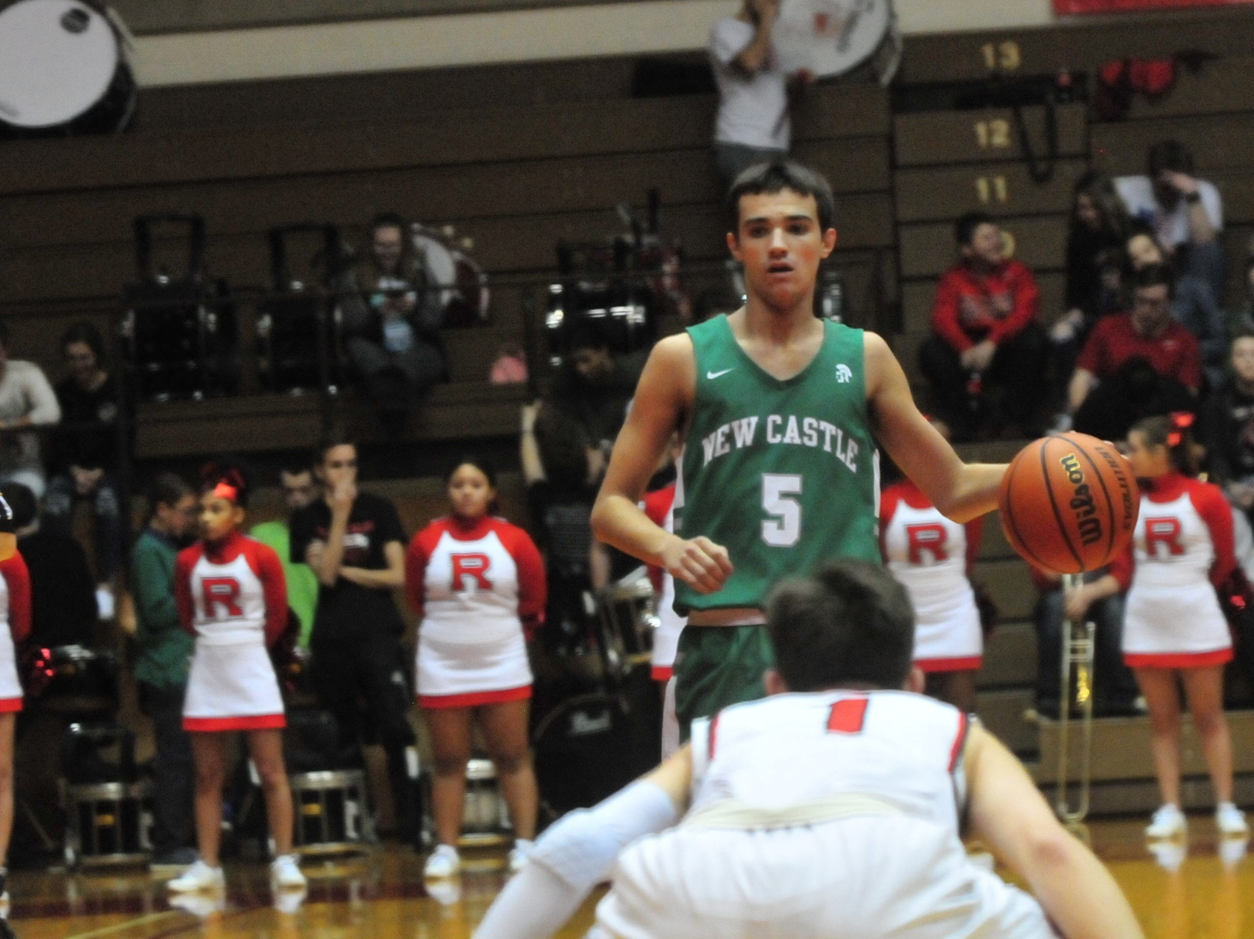 New Castle senior Blake Burris (5) moves the ball during a boys basketball game against Richmond at Tiernan Center Friday, Jan. 4, 2019.