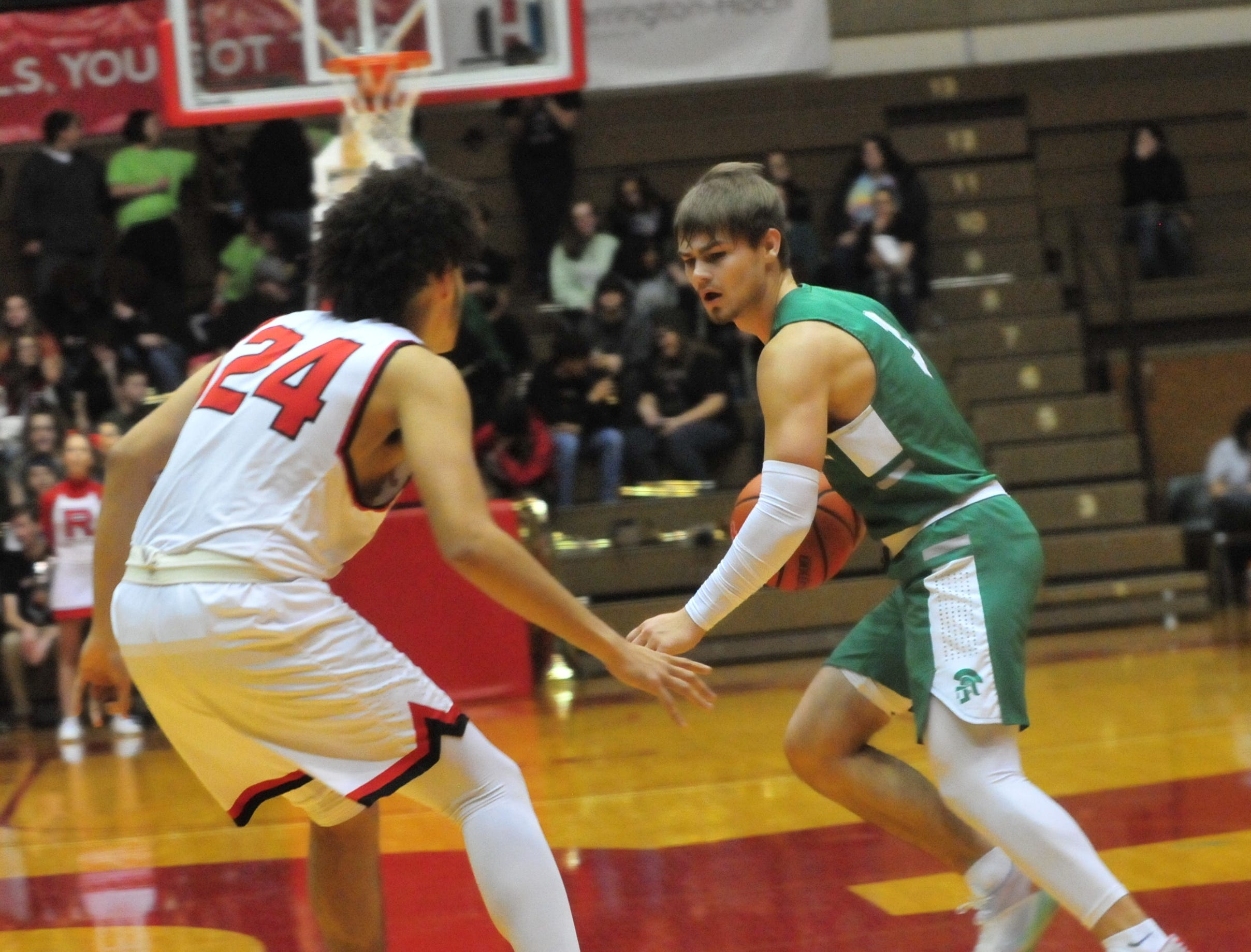 New Castle's Luke Bumbalough (3) moves the ball against Richmond's Jordan Frye during a boys basketball game at Tiernan Center Friday, Jan. 4, 2019.