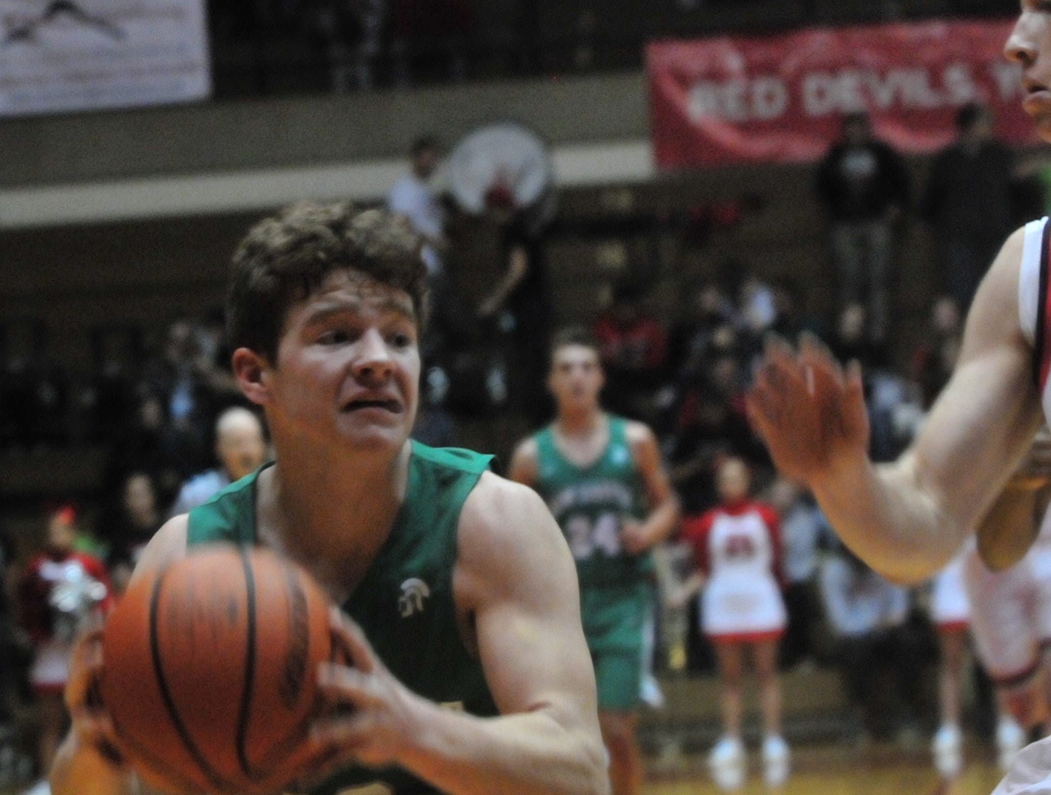 New Castle's Mason Hardwick (10) makes a move to the basket during a boys basketball game against Richmond at Tiernan Center Friday, Jan. 4, 2019.