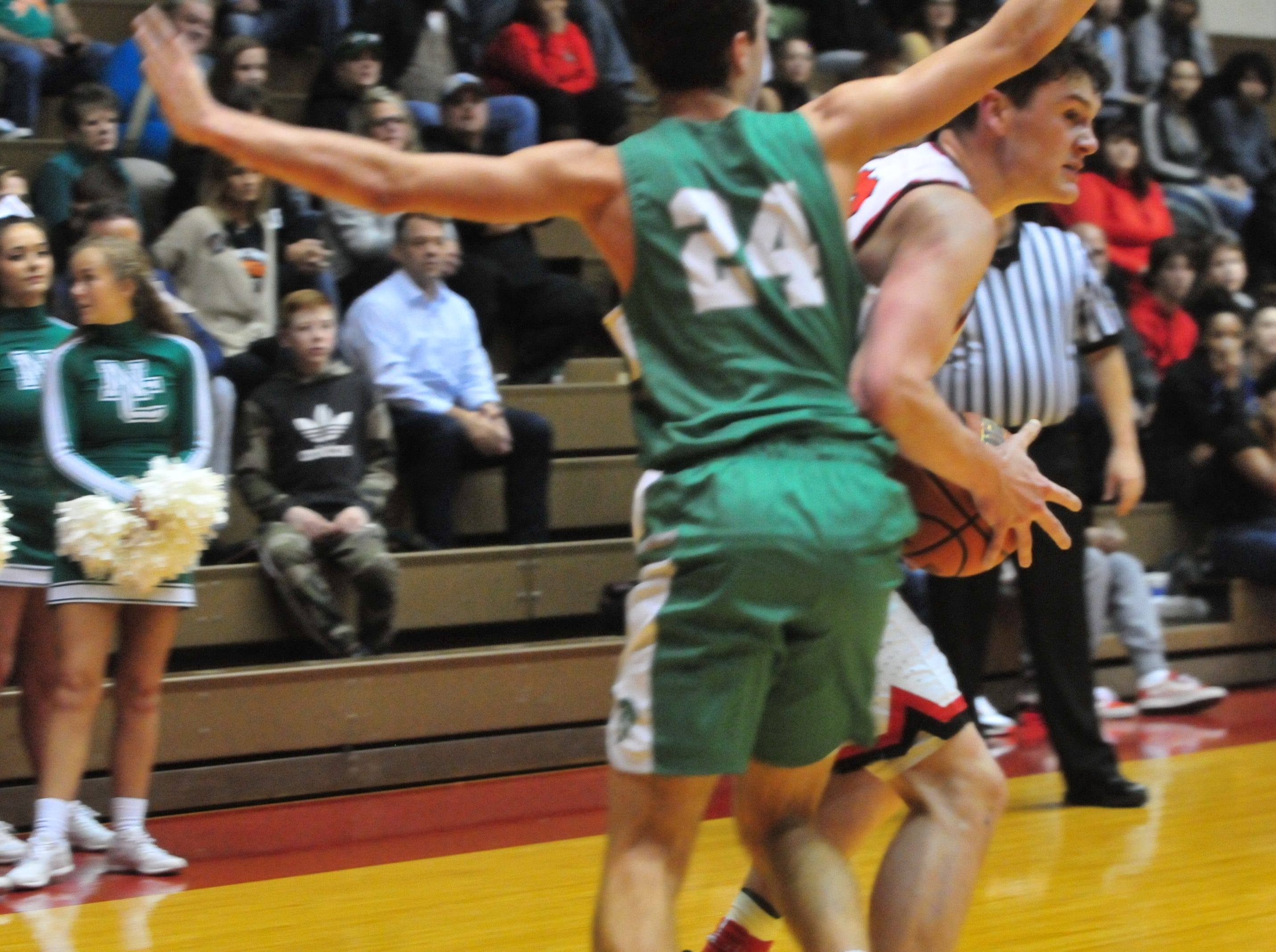 Richmond High School senior Lucas Kroft (10) moves the ball against New Castle's Nicholas Grieser (24) during a boys basketball game at Tiernan Center Friday, Jan. 4, 2019.