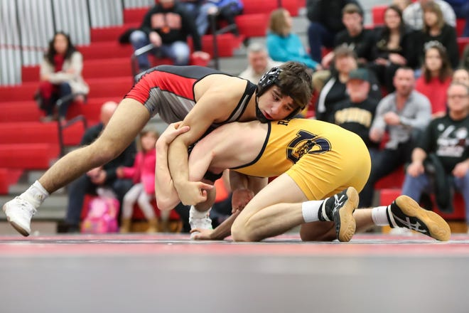 Hilton's Greg Diakomihalis gets the advantage over Spencerport's Aiden Conn in the 120 pound weight class during the Section V high school Division I wrestling dual meet championship at Hilton High School on Jan. 5, 2018.