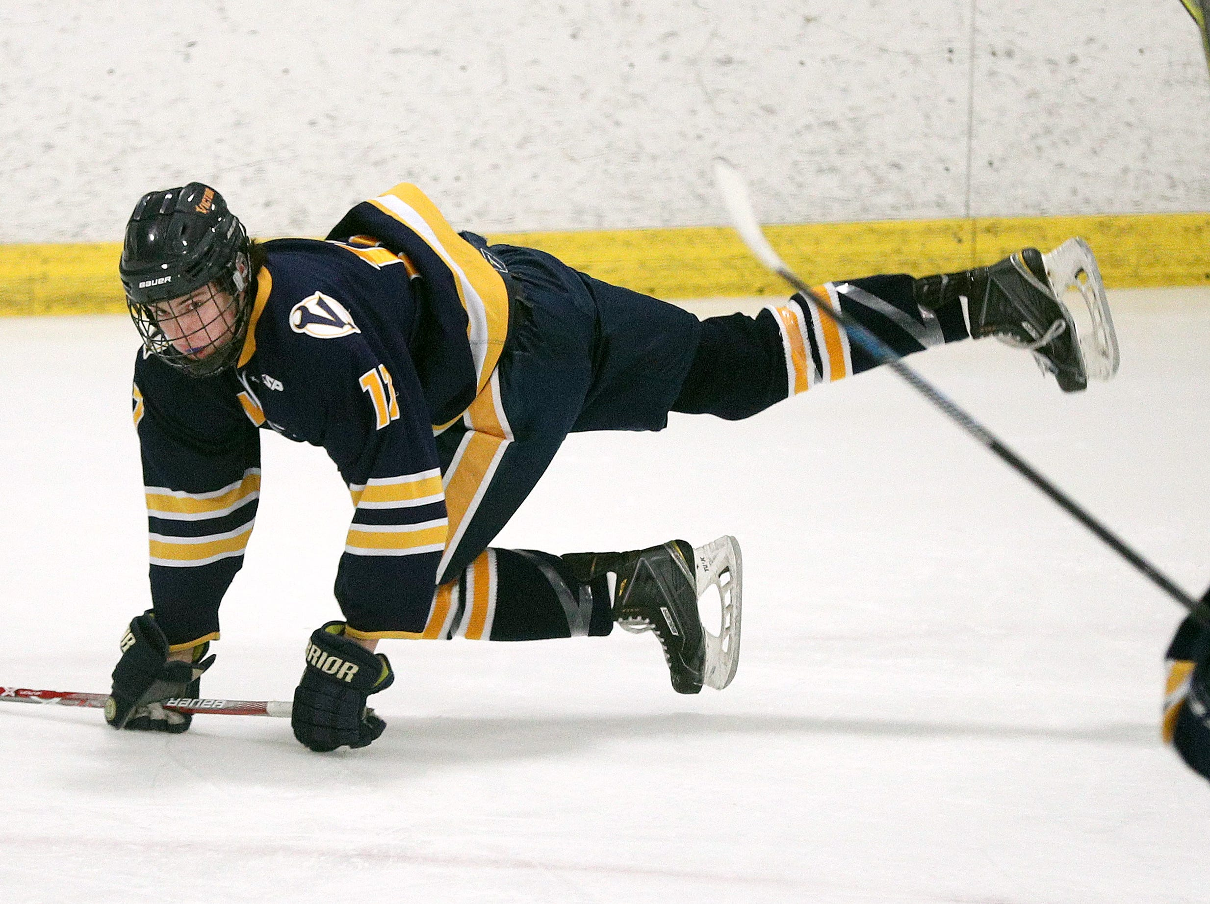 Victor's Roman Czornobil is checked to the ice against Fairport.