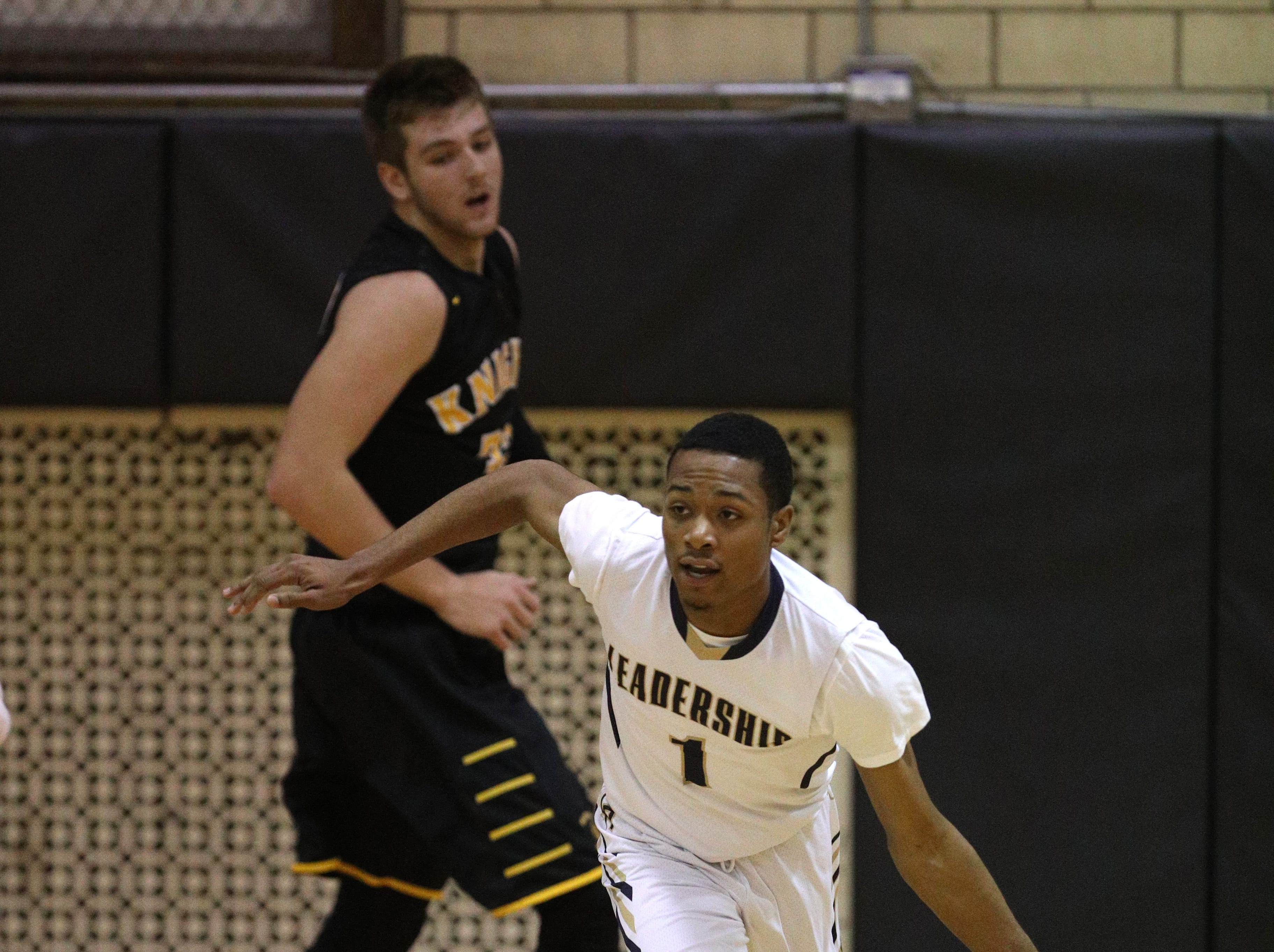 Leadership's Onajae Anderson  pushes the ball up the court against McQuaid.