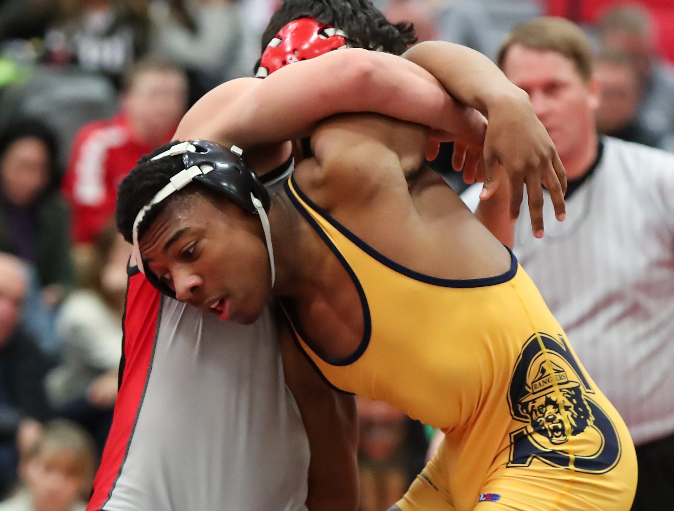 Spencerport's Dexter Craig wrestles Hilton's Mike Fronczak in the 160 pound weight class during the Section V high school Division I wrestling dual meet championship at Hilton High School on Jan. 5, 2018.