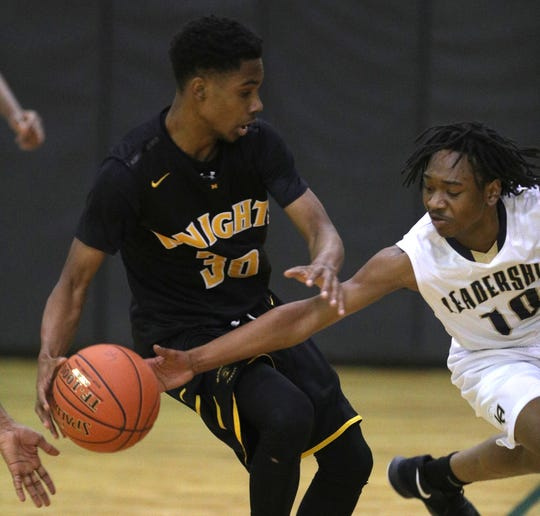 Leadership's Rondell Watson (10) tries for the steal against McQuaid's Kobe Long.