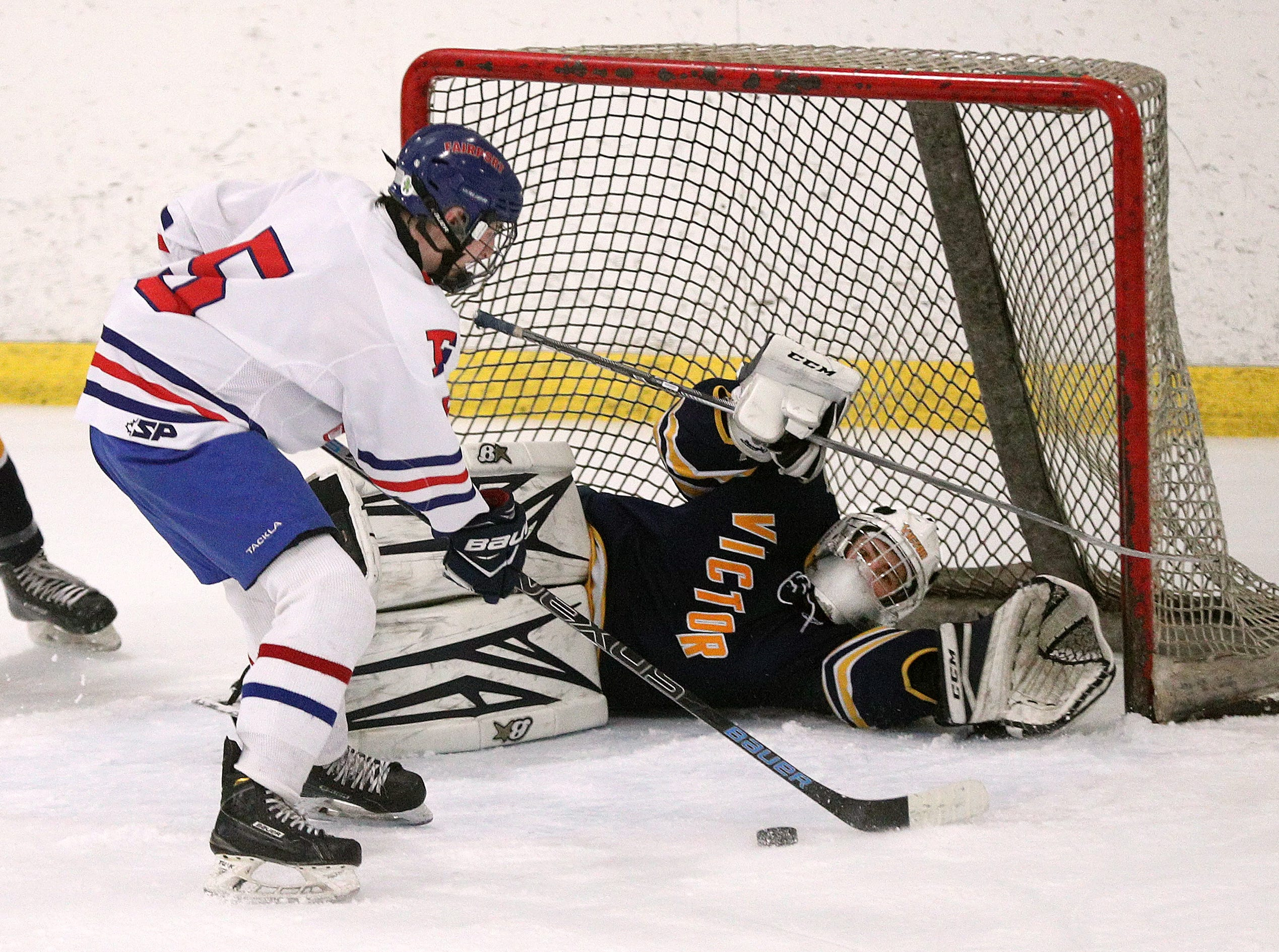 Victor goalie Pieter Bartelse makes this save on a shot by Fairport's Sam Hoyen from in front of the net.