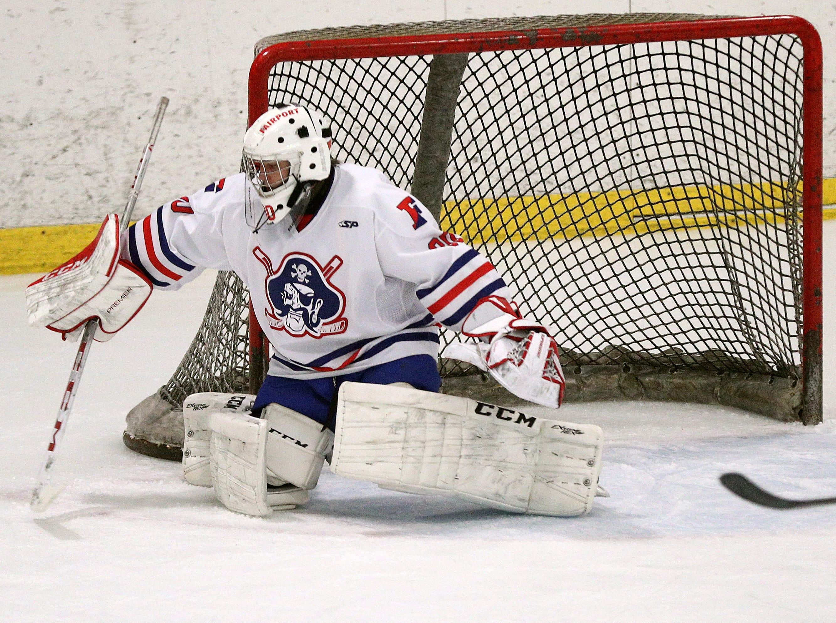Fairport goalie Tyler McMillan  pushes this shot to the side against Victor.
