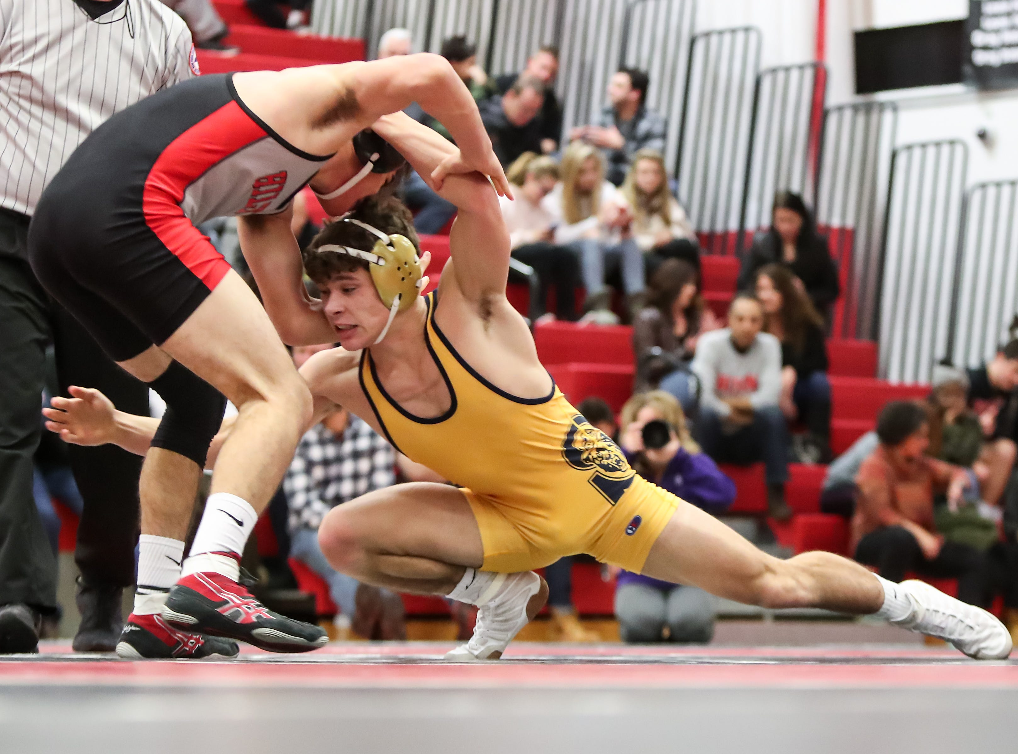 Spencerport's Mason Wersinger shoots Hilton's Jacob Soricone leg in the 145 pound weight class during the Section V high school Division I wrestling dual meet championship at Hilton High School on Jan. 5, 2018.