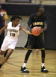Leadership's Rondell Watson (10) comes from behind to steal the ball away from MCQuaid's Rueben Daniel.