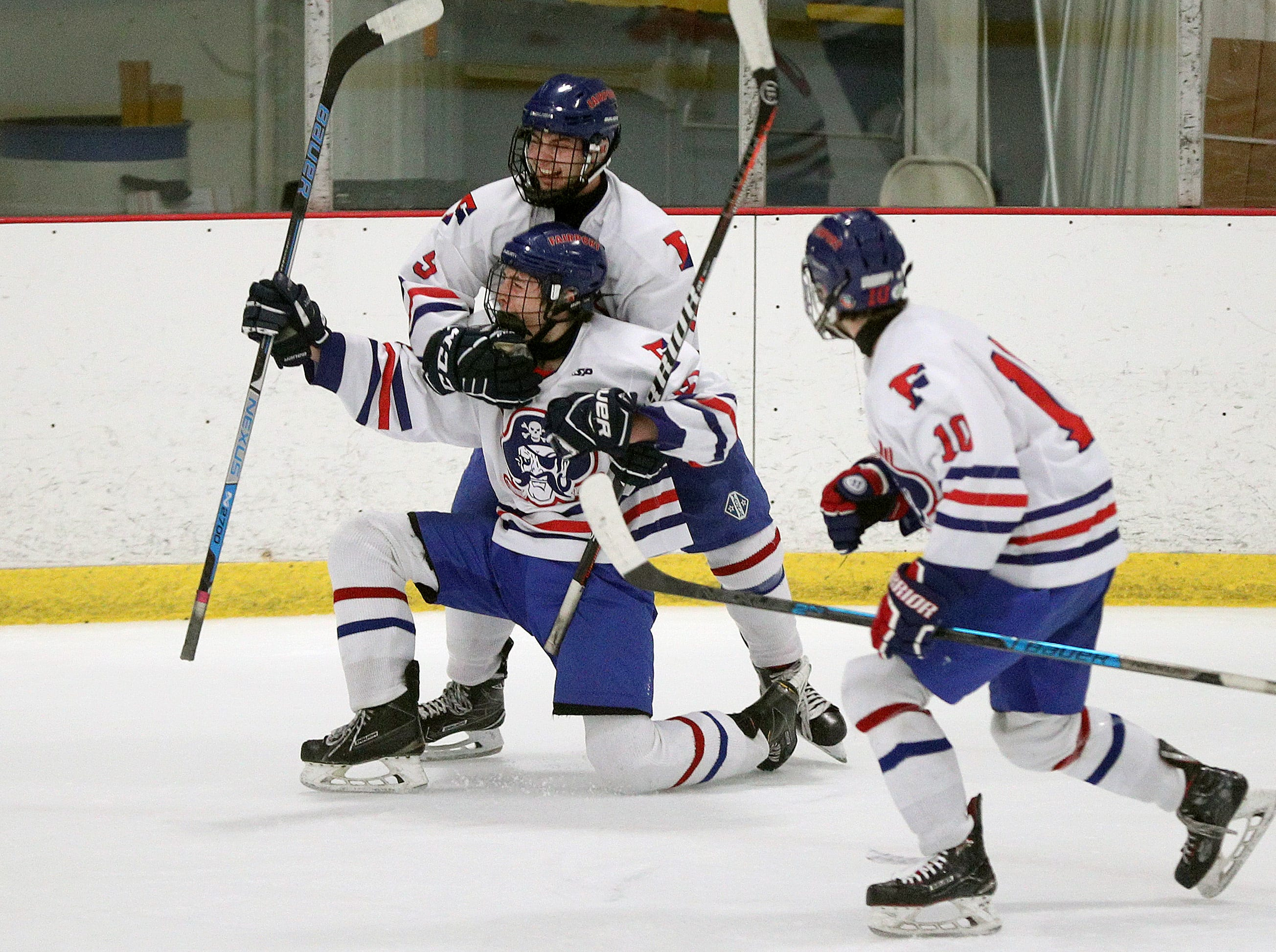 Fairport's Sam Hoyen celebrates his goal with teammates Nick Lipari and Jake Mueller (10) against Victor.