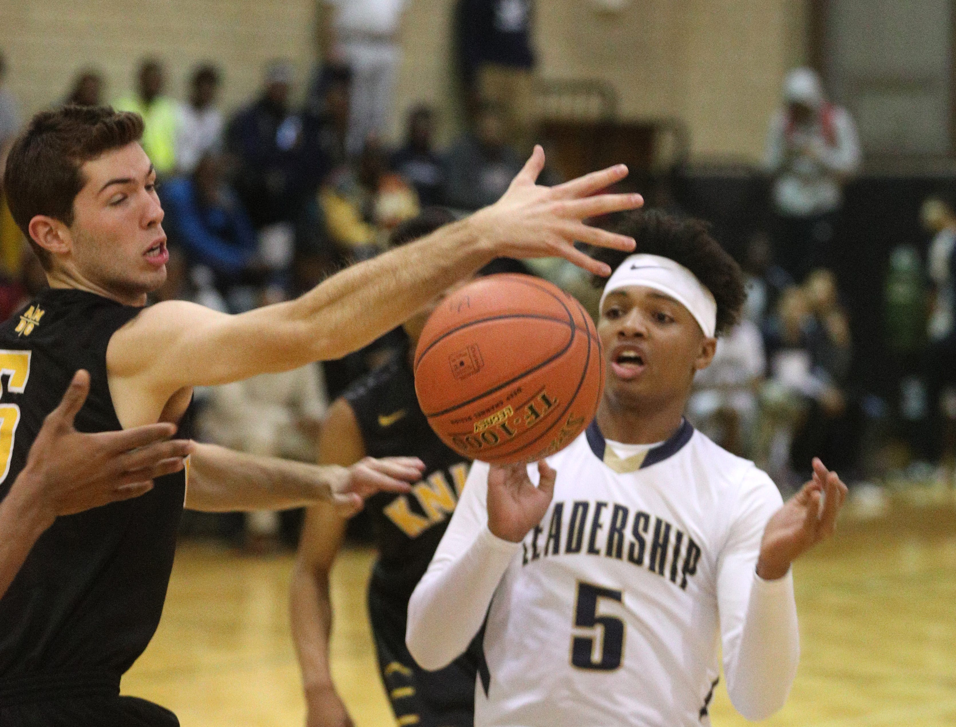 Leadership's Maurice McKinney and McQuaid's Michael Maloney try to control a rebound.