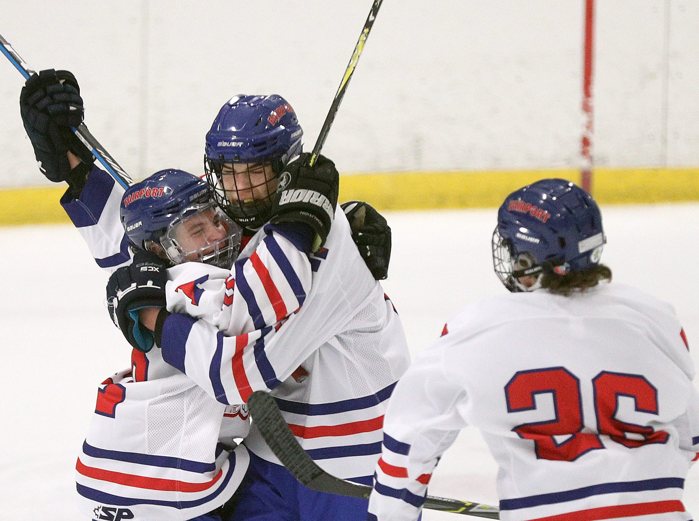 Fairport's Hunter McDonald (center) celebrates his goal with Travis Knicley and Nick Krug (26).