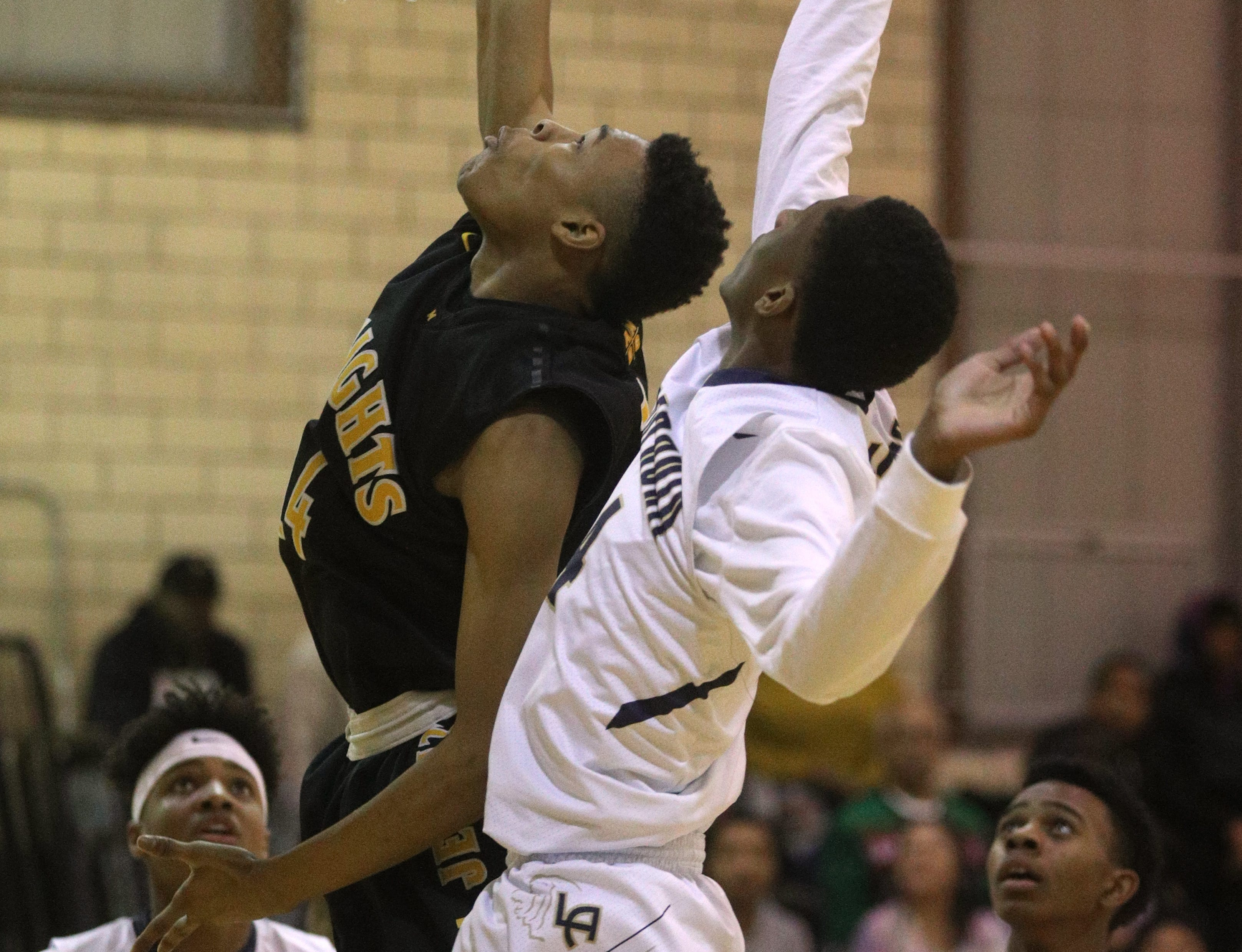 McQuaid's Jermaine Taggart goes to the basket in ahead of Leadership's Kennyh Hardeman.