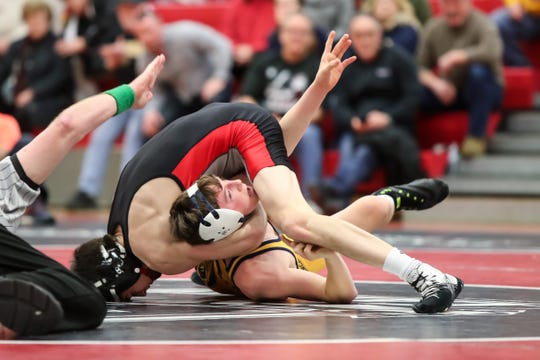 Hilton's Gregor McNeil pins Spencerport's Cal Russo in the 106 pound weight class during the Section V high school Division I wrestling dual meet championship at Hilton High School on Jan. 5, 2018.