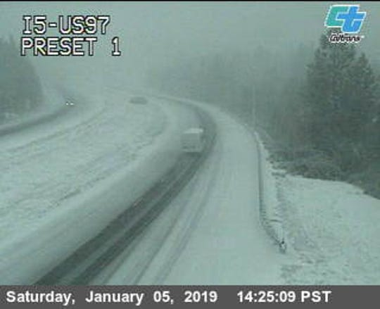 A traffic cam along Interstate 5 near Highway 97 shows plenty of snow Saturday afternoon in Siskiyou County.