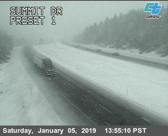 Snows blankets the ground Saturday afternoon along Interstate 5 near Summit Drive in the Mount Shasta area.
