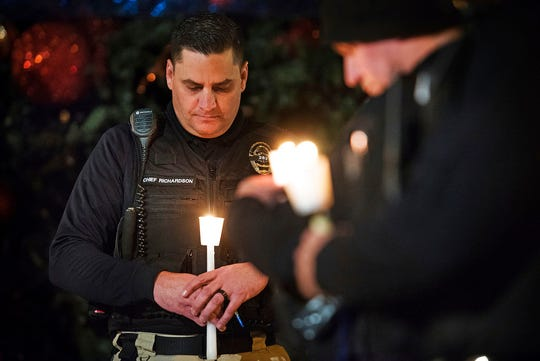 In this Friday, Dec. 28, 2018 file photo, Newman Police Chief Randy Richardson and hundreds of others attend a vigil in memory of police Cpl. Ronil Singh in Newman, Calif. The Northern California police officer was gunned down during a traffic stop the day after Christmas 2018.