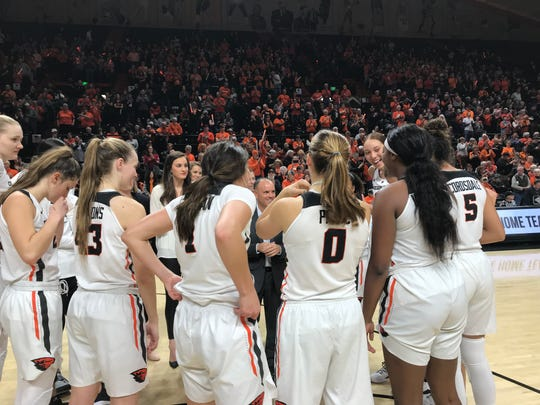 Oregon State players gather around coach Scott Rueck before the opening tip against Washington State at Gill Coliseum, Jan. 4, 2019.